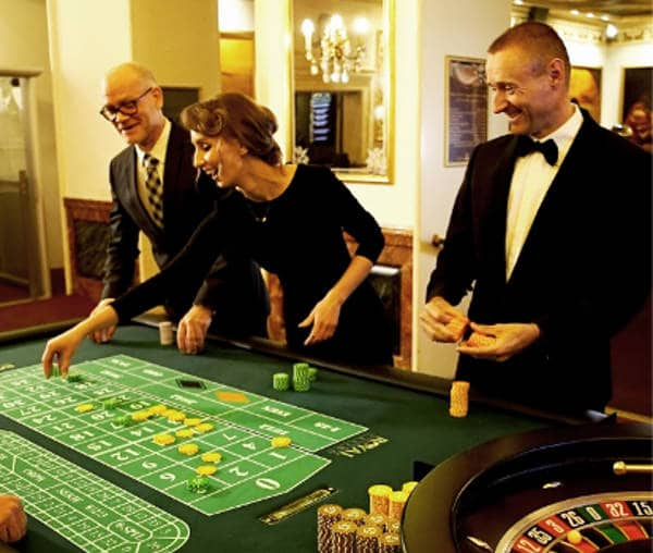 players at the table in the Royal Casino