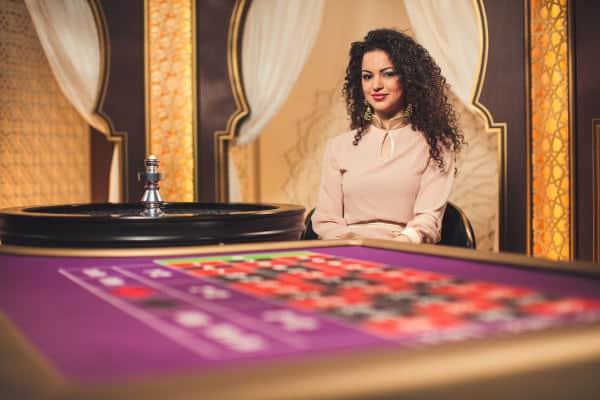 evolution arabic roulette brunette dealer