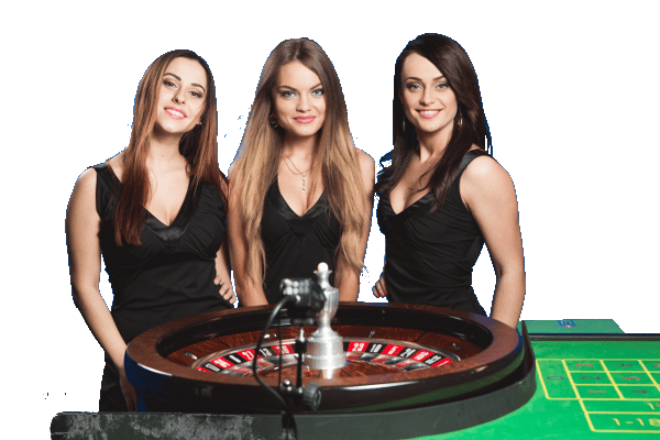 3 female live dealers standing next to a live roulette wheel