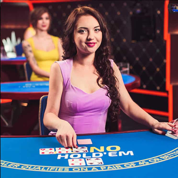 female dealer at Ezugi Live Casino Holdem table