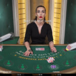 Live Dealer dealing blackjack cards
