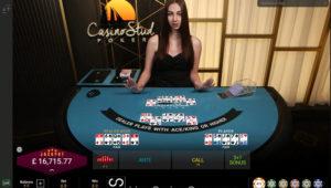 Croupier dealing a live hand of casino stud poker