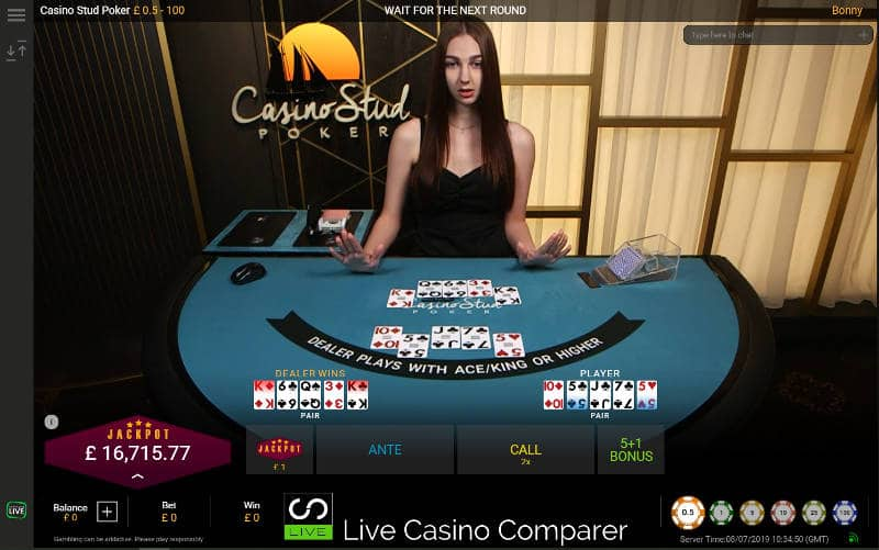Croupier dealing a live hand of casino stud poker