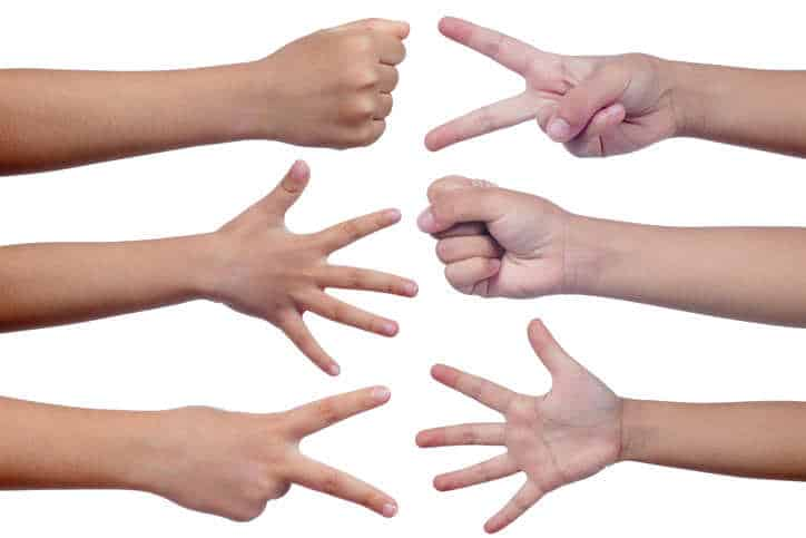 Child's hands making sign as rock paper and scissors