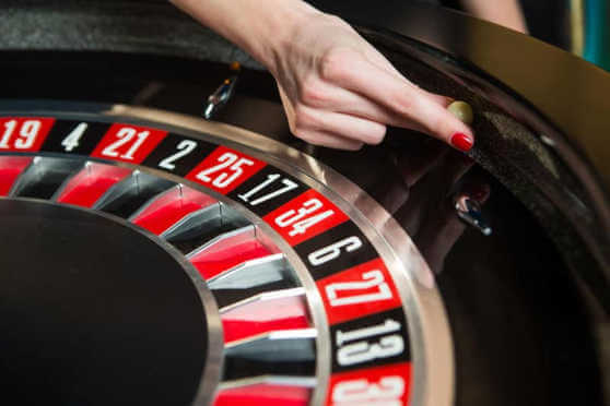 Roulette wheel with ball and hand